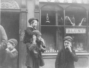 Poor boys, typical of the families helped, outside Blunt's Chemist on Wyle Cop in 1889. Robert Blunt (c1766 - 1842) was Treasurer of the charity for many years, and provided medicines without charge to the charity or those helped. For much more information about the Blunt family see here. Picture used by permission of the Master and Fellows of St John's College.